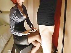 Matured redhead gives her slave slut a footjob