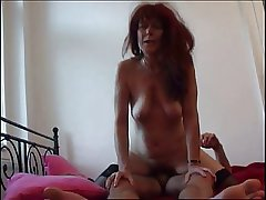 Redhead Mom forth stockings blowing cock plus fucking