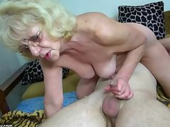 HOT Young guy making out granny with strap-on