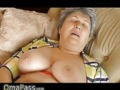 Granny with big baggy titties masturbating atop someone's skin divan