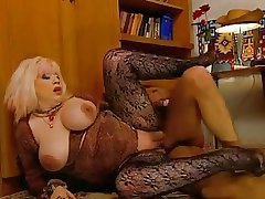 Slutty Granny Zhanna beside stockings rewards voyeur thither a fuck