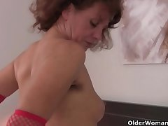 Hairy grandma Inge in red stockings is fingering the brush full bushed pussy