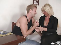 Aged blonde is doggy-style fucked