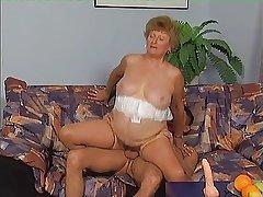 Granny in Stockings Pressing Cock