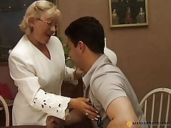 Senior dame giving a sex lesson
