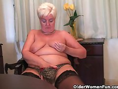 Chubby granny in stockings plays less vibrator