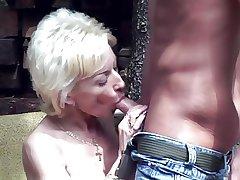 torrid granny lets him test her new tits