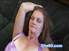Horny redhead granny fucks her shaved pussy at hand a dildo