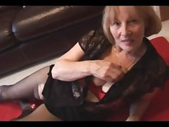 Busty tow-headed granny rips pantyhose to fake off hairy pussy