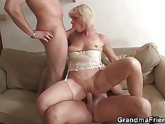 Lonely granny swallows duo cocks