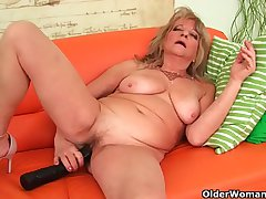 Grandmother with fruitful breasts pushes socking dildo medial