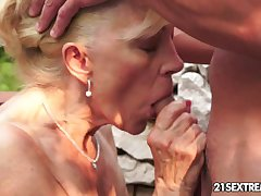 Mature Szuzanne plays nearby a young cock