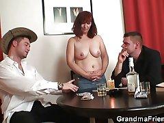 Granny swallowing three beamy cocks