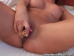 Sultry Granny Probes Her Old Pussy With A Dildo