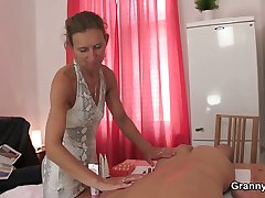 Granny masseuse loves sucking coupled with riding his young cock