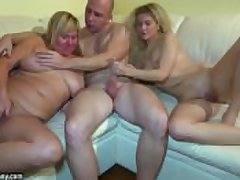 Young girl going to bed in threesome with granny