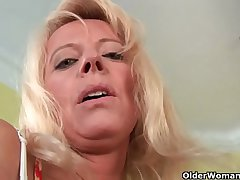 Sultry senior mommy probes her old pussy with a large dildo