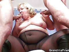 Huge titted grandma swallows three cocks