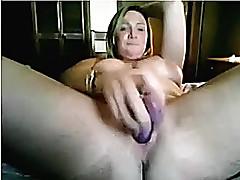 Big tit woman penetrates her tinker take her large plastic fake dick