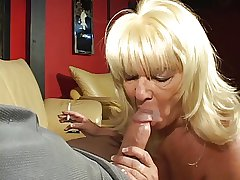 Blonde adult cock sucking granny enjoys a ciggy and a hard dick