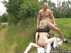 Old whore takes two dicks open-air