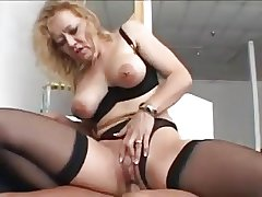 Scrupulous blonde granny in stockings fucks a younger man