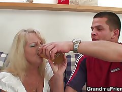 Blonde grandma takes two heavy cocks to hand once
