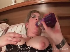 Adult in glasses fucks himself with big dildo