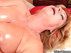 Grandma with big chest finger fucks the brush oiled pussy
