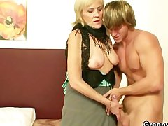 Venerable whore rides young cock