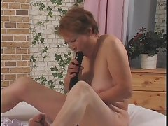 Nasty grandma getting her old pussy fucked to a dildo apart from young womanhood