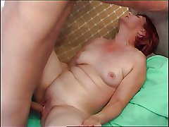 Red-haired Granny seduces cute university schoolboy