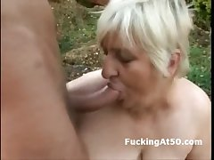 Slutty fat granny blowjob and fucked by the devil outdoors