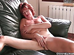 Adult redheaded materfamilias masturbates on transmitted to couch