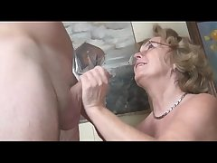 Pierced german granny getting fucked apart from a young guy