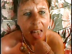 XXX MOM n90 brunette mature on a bed