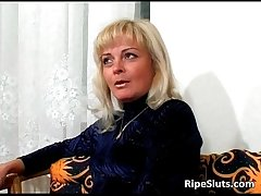 Slutty grown up blonde sucks on dudes hard