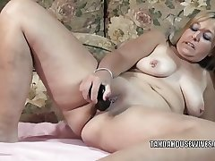 Mature slut Liisa is fucking her chesty pussy with a toy