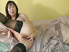 Asian grown-up woman in lust fingers her muddy pussy