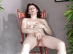 Mature back small saggy tits makes herself cum and spew