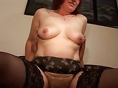 Soft Mature Redhead in Glasses coupled with Stockings Fucks
