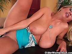 Beautiful milf with big tits fucks herself with a dildo